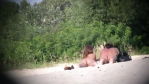 Hot couple of beach nudists voyeured on spycam from behind