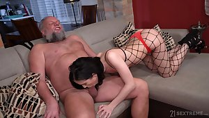 Bearded berate is happy to lick pussy of gal in fishnet tights Nikki Fox