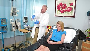Blonde pornstar Kit Mercer spreads her legs to pleasure her doctor